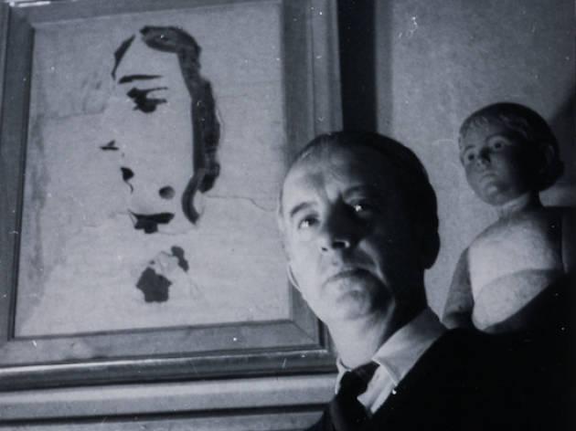 Paul Eluard amb Picasso fons
